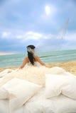 Bride in bed at the coastline. Stock Photos