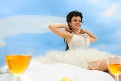 Bride in bed at the coastline Stock Images