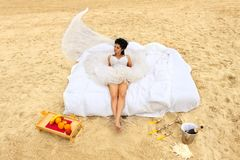 Bride in bed at the coastline. Stock Photography