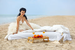 Bride in bed at the coastline Royalty Free Stock Photos