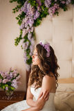 The bride on a bed with a lilac Stock Photography