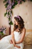 The bride on a bed with a lilac Royalty Free Stock Photo