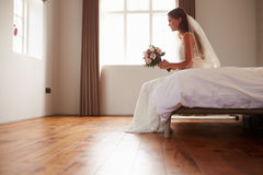 Bride In Bedroom Having Second Thoughts Before Wedding Stock Image