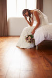 Bride In Bedroom Having Second Thoughts Before Wedding Stock Photography