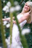 Bride behind flowers Royalty Free Stock Photo