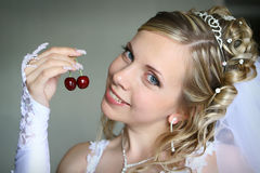 Bride with berry. Beautiful bride with sweet cherry Stock Image