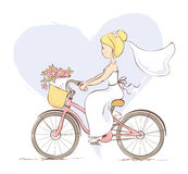 Bride on a bicycle Stock Photography