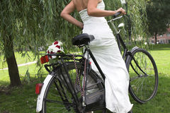 Bride on a bike Royalty Free Stock Images
