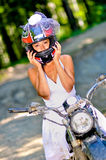 Bride on bike. A just married young bride on the bike royalty free stock photo