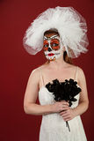 Bride with Black Roses. Bride in makeup with a bunch of black roses for Dia De Los Muertos Royalty Free Stock Photo