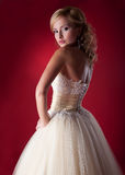 Bride blonde - wedding model. Bride in bridal dress on a red background Stock Photo