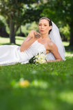 Bride blowing a kiss in park Royalty Free Stock Photos