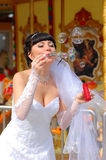 Bride blows soap bubbles Stock Image