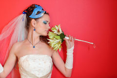 Bride with blue makeup and mask in hairdo Stock Images