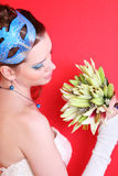 Bride with blue makeup and mask in hairdo Royalty Free Stock Image