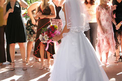 Bride boquest toss. A bride preparing to throw a boquet royalty free stock images