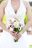 Bride and Boquet. A bride in a white gown holding a boquet of flowers Stock Photography