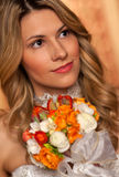 Bride with boquet. Portrait of young bride in wedding dress with boquet stock photos