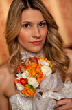 Bride with boquet. Portrait of young bride in wedding dress with boquet stock photography