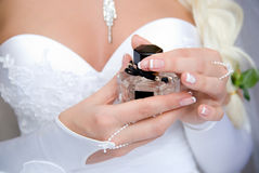 The bride with a bottle of perfume Royalty Free Stock Image