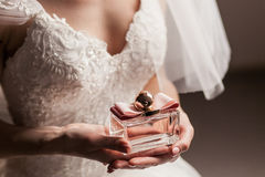 The bride with a bottle of perfume Royalty Free Stock Images