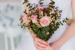 Bride with bouqet. Bride with beautiful wedding bouqet closeup shot royalty free stock image