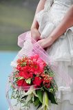 Bride with bouquet. Bride with colorful bouquet in hand Royalty Free Stock Photography