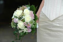 Bride and bouquet. Bride is holding her wedding bouquet Stock Image