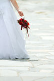 Bride and bouquet. Wedding red bouquet flowers and bride Stock Photography
