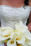 Bride with bouquet. Caucasian bride with embellished white wedding dress and bridal bouquet Royalty Free Stock Photo