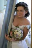 Bride with a bouquet. The bride with a bouquet in hands some minutes prior to wedding ceremony Stock Photos