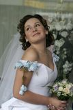 Bride with a bouquet. The bride with a bouquet in hands some minutes prior to wedding ceremony Stock Images