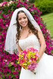 A bride with a bouquet. In red, pink, green, and orange Stock Images