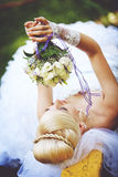 Bride with bouquet. Girl in a wedding dress with a bouquet Royalty Free Stock Photo