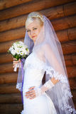 Bride with bouquet. Girl in a wedding dress with a bouquet Royalty Free Stock Image