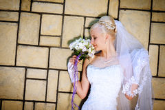 Bride with bouquet. Girl in a wedding dress with a bouquet Stock Photo