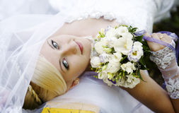 Bride with bouquet. Girl in a wedding dress with a bouquet Stock Image