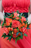 Bride bouquet. Red roses  flowers bride bouquet with unconventional red dressed bride Stock Photo