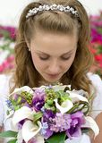 Bride and Bouquet. Beautiful bride looking at her bouquet Stock Photography
