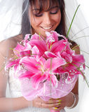 Bride with bouquet. Young bride with bouquet of lilys on a white background Royalty Free Stock Images