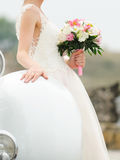 Bride with Bouquet at Car Stock Images