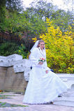 The bride with a bouquet in the fall Royalty Free Stock Images