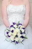 Bride bouquet and dress detail Stock Photography