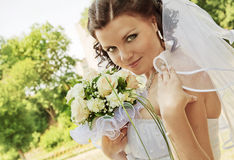 The bride with a bouquet of flowers. Royalty Free Stock Images