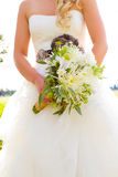 Bride and Bouquet Flowers Stock Images