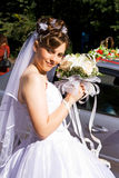 Bride with bouquet of flowers Stock Images