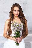 Bride with bouquet of flowers Royalty Free Stock Image