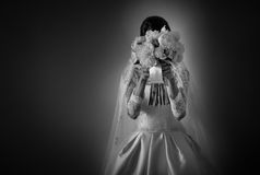 Bride with bouquet of flowers. Bride holding a gorgeous bouquet of flowers Royalty Free Stock Image