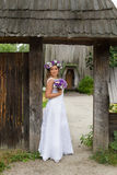 The bride with a bouquet of flowers posing in the photo on the nature. Beauty bride in bridal gown with bouquet and lace veil on the nature. Beautiful model girl Royalty Free Stock Photos