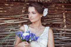 Bride with a bouquet of flowers. Romantic bride with bouquet of flowers Royalty Free Stock Image